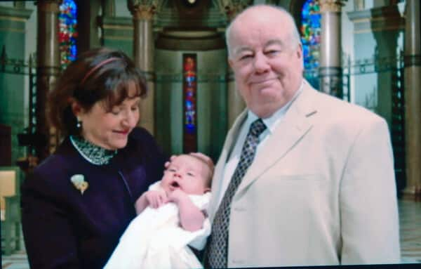 Little Josh's baptism at the Cathedral by Father Mike